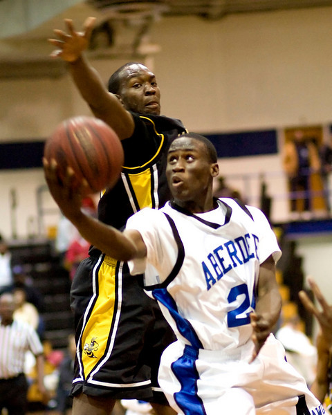 Shedrick Davis of Aberdeen drives under the block attempt of Starkville's Chris Brand for a score