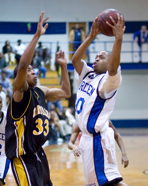 Aberdeen's William Curry shoots around Starkville's Rashad Perkins