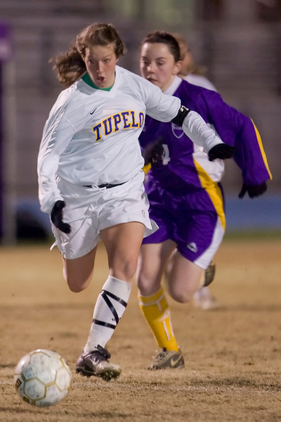 Tupelo's Meghan Brown breaks free from defender Brook Farly for one of her two goals Wednesday night.