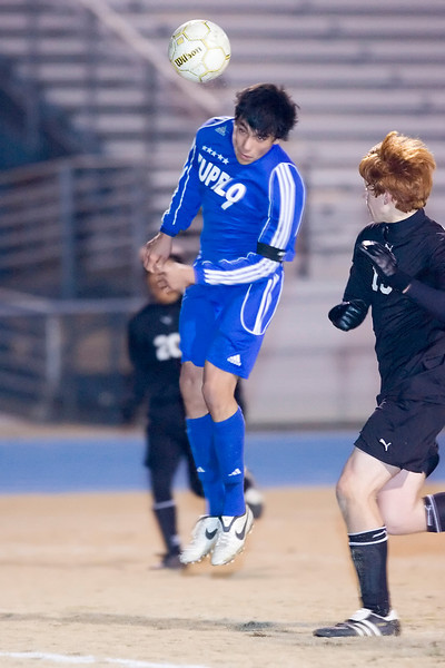 Tupelo's Junior Garcia heads a corner kick