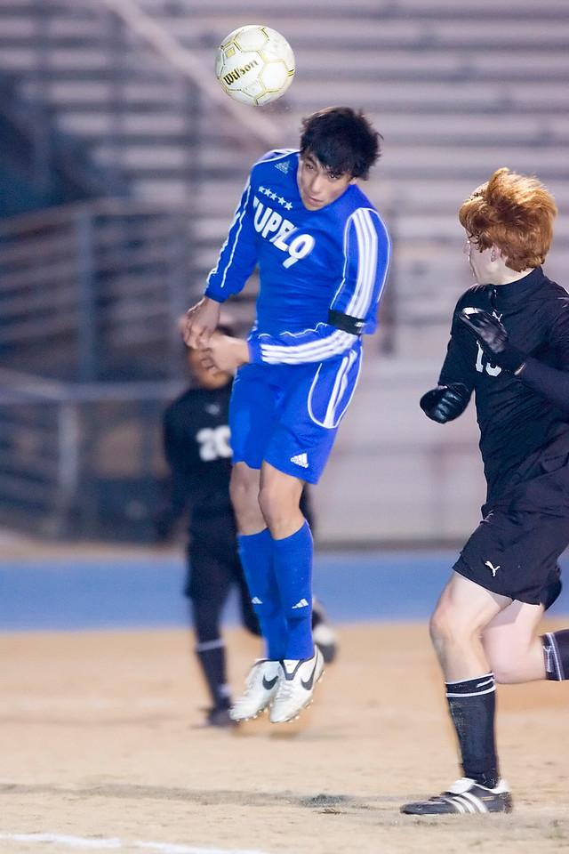 Tupelo's Junior Garcia heads a corner kick