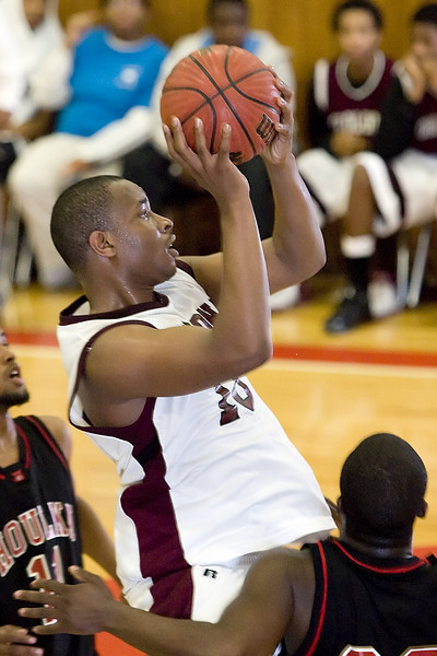 Jeremy Newsome of Okolona drives for two