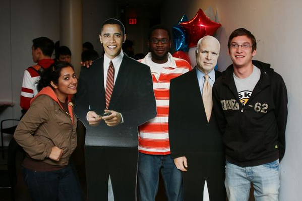 """<a href=""""http://www.dailyprincetonian.com/slideshows/140/expand/""""><i>The Daily Princetonian,</i> November 5, 2008 - """"Election 2008""""</a>  Caption: Zahrah Masheeb '10 (l.), Pinto Adhola '10 (center) and Josh Hoff '10 pose with Obama and McCain cutouts at the election watching party in Whig Hall."""