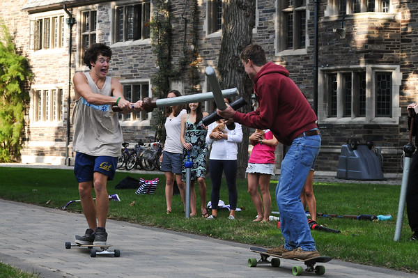"""<a href=""""http://www.dailyprincetonian.com/frontpage/2009/10/05/snapshot/""""><i>The Daily Princetonian,</i> October 5, 2009 - Front Page Standalone</a>  Caption: Colin Hanna '11 and Elliot Welder '10 spend a sunny afternoon mixing the archaic pursuit of jousting with the modern skateboard."""