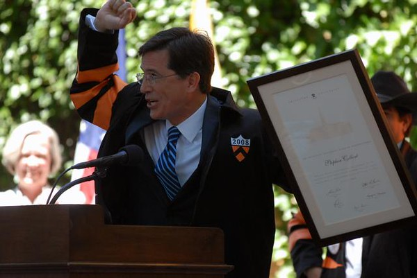 "<a href=""http://www.dailyprincetonian.com/2008/06/02/21265/""><i>The Daily Princetonian,</i> June 2, 2008 - ""Colbert to Class of 2008: Don't change the world""</a>  Caption: Stephen Colbert thanks the assembled graduating seniors after being granted an honorary degree at Class Day. In his speech to the graduating class, Colbert playfully urged them not to change the world because ""some of us like it the way it is."""