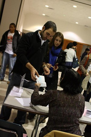 "<a href=""http://www.dailyprincetonian.com/slideshows/140/expand/""><i>The Daily Princetonian,</i> November 5, 2008 - ""Election 2008""</a>  Caption: Selcuk Arkun '10 and Liz Consky '10 check in to vote at Trinity Church on Tuesday."