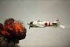 A Japanese Zero breaks through the explosion after a bombing run at the Vectren Dayton air show