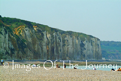 The chalk cliffs bordering both sides of Dieppe beach. There are many small caves in which the Germans had mounted machine guns. On the top of the cliffs they had large artillery pieces.