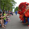 Nguyen Nguyen and his daughter Katarina of Dorchester greet lion dancers near Lower Mills.