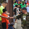 Dan Luker of the Smedley D. Butler Brigade Veterans for Peace reaches out near Fields Corner.