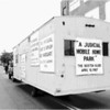Parade float entered in 1987 by former presiding justice James Dolan to call for a permanent expansion at Dorchester District Court, instead of the overflow trailers.