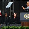 Speaking at podium: President Obama.