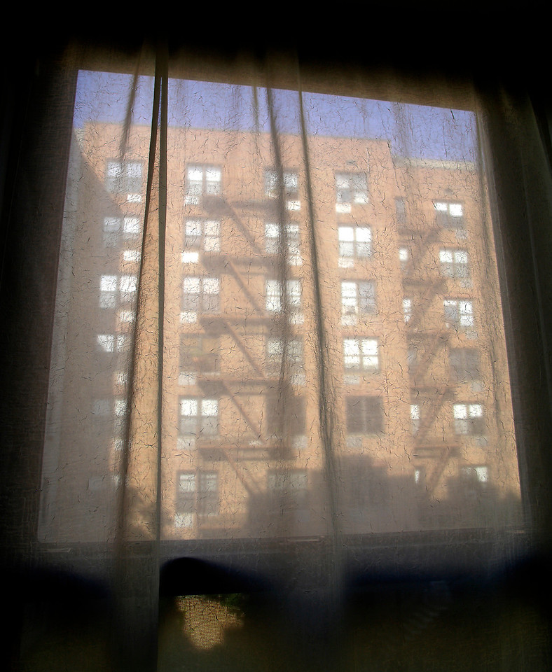 Sanctuary<br /> NYC<br /> <br /> Looking out from inside the comfort and security of an apartment, edginess of the street below is muted and filtered out by a softly veiled view.  <br /> <br /> One's home is one's castle.<br /> <br /> In a big city that castle has a sanctuary feel.