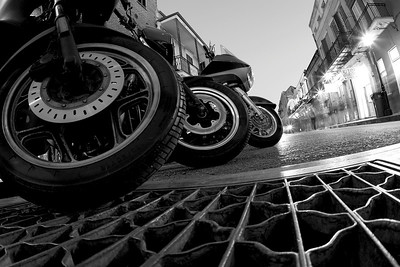 Motorcycle wheels parked at night in the Garden district of New OrLeans, LA