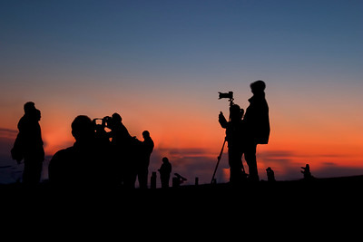 Photographers at night waiting for the perfect shot. Overlooking San Francisco Bay