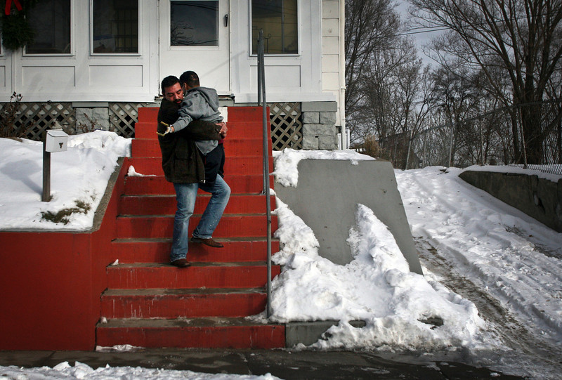 RENEE JONES SCHNEIDER ï reneejones@startribune.com West St. Paul, Mn- 12/12/07 - Mario Cabral carried Benjamin Ruiz down the steps of Father Kevin Kenney's house in West St. Paul as they prepared to leave for the airport where Father Kenney was bringing Ruiz home to Mexico.
