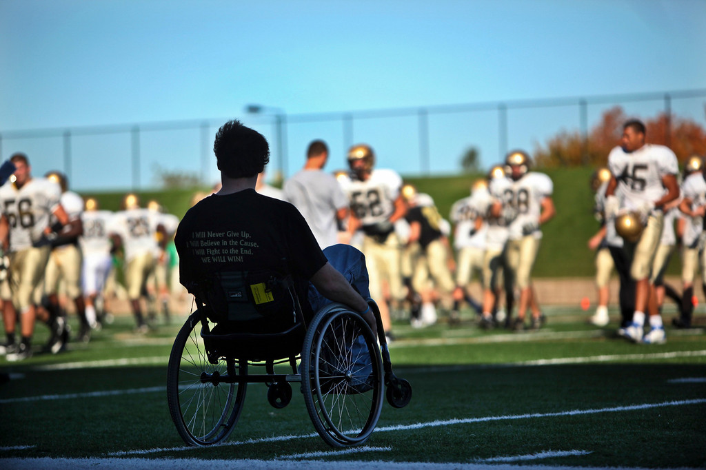 RENEE JONES SCHNEIDER • reneejones@startribune.com  Marshall, Minn. - 9/29/10 - GENERAL INFO - This May,  Derek Klinkner, a top defensive football player at Southwest Minnesota State University in Marshall, broke his back in a farming accident leaving him unable to walk and using a wheelchair.  He still participates in the football team, attending practices and all games.  He hopes to regain the uses of his legs over time.  He is not paralyzed and has some movement in his legs.  - IN THIS PHOTO ] Derek Klinkner watched as the SMSU football team broke from a huddle at practice Wednesday in Marshall. Klinkner broke his back in a farming accident this spring leaving him unable to walk.  He still participates in the football team where he was a top defensive player.