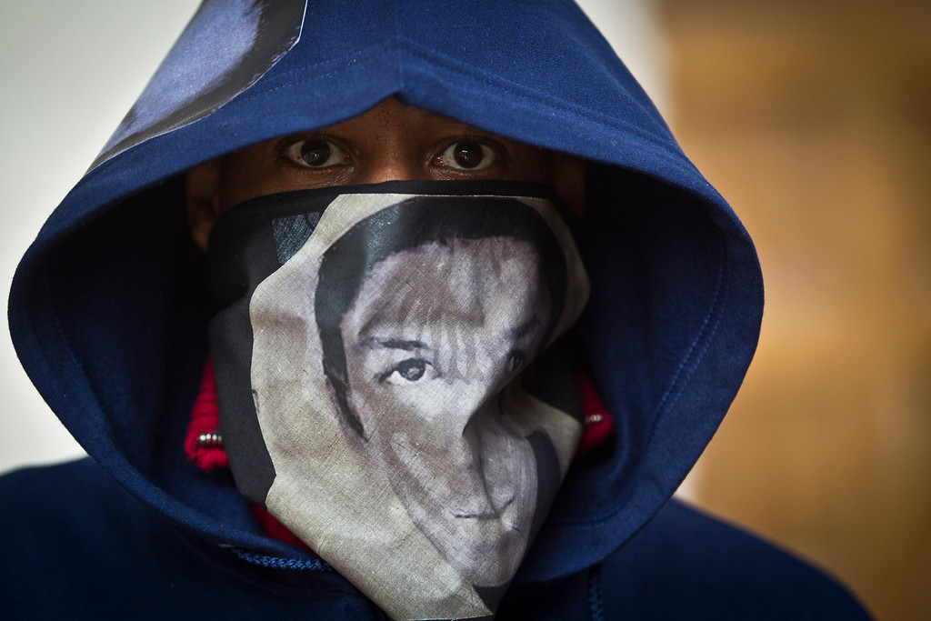 "A man who referred to himself as only youngblackmale wore a hoodie and scarf depicting Trayvon Martin during the ""One Thousand Hoodies March for Trayvon Martin""  Thursday night, March 29, 2012 at the University of Minnesota campus in Minneapolis, Minn."
