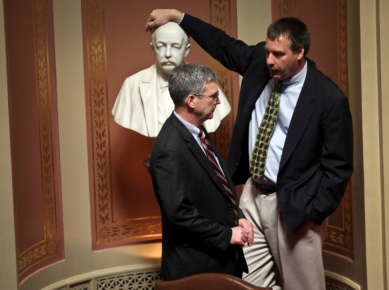 Sen. David Hann chatted with Sen. Chris Gerlach, who leaned on a bust of former Gov. Cushman Davis, as they waited for the start of a special session at the State Capitol in St. Paul, Minn., Tuesday, July 19, 2011.
