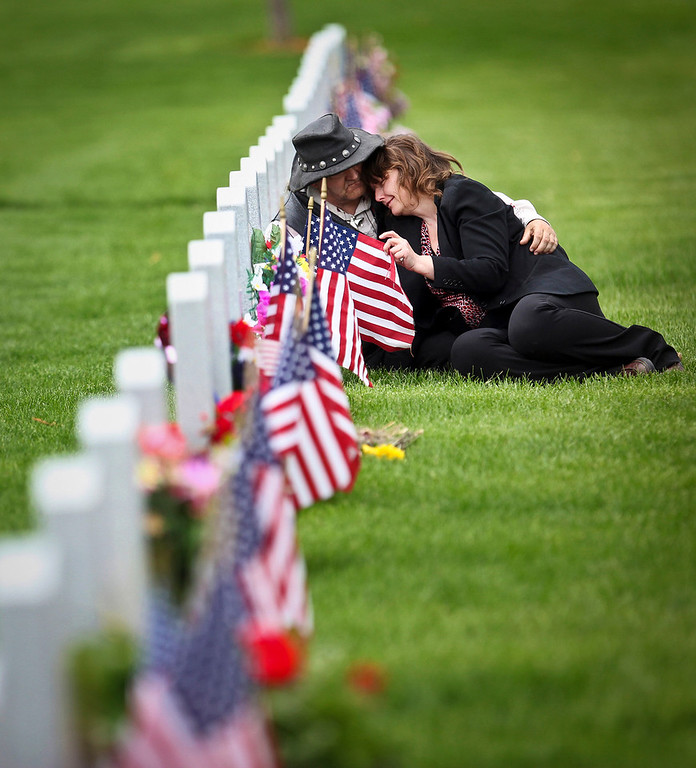LaWanna Capistrant of Browerville was comforted by her boyfriend Paul Meres as she visited the grave of her son Dennis Capistrant who died the day before his 30th birthday in October 2010 in a car accident  with his father.  Dennis was a Marine Corps veteran who served in Kosovo and later an Army National Guard member. LaWanna was at a Memorial Day program at the State Veterans Cemetery in Little Falls with her family.