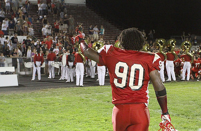 31aug12 bishop--- Elyria High vs Elyria Catholic--- Elyria 90 Tracy Sprinkle points to the crowd who were cheering him as he came off the field after the win over EC