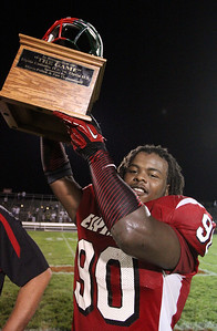 31aug12 bishop--- Elyria High vs Elyria Catholic---Elyria High star Tracy Sprinkle holds the Helmet Trophy after dominating Elyria Catholic