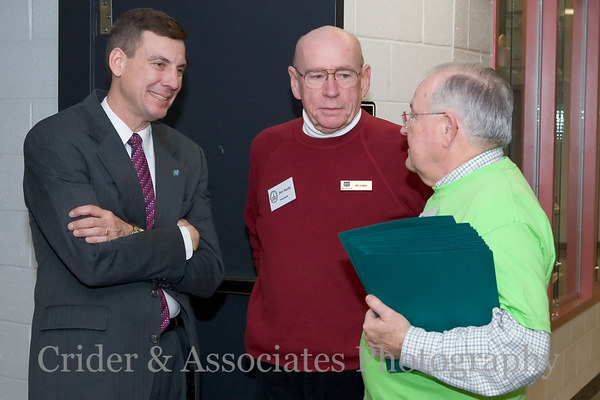 (Left) Gainesville District Supervisor John T. Stirrup chats with local volunteers prior to the Emergency Town Hall meeting.