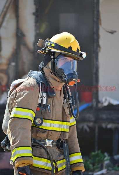 A firefighter on the scene of a residential working structure fire in Ellicott, Colorado. April 8, 2015