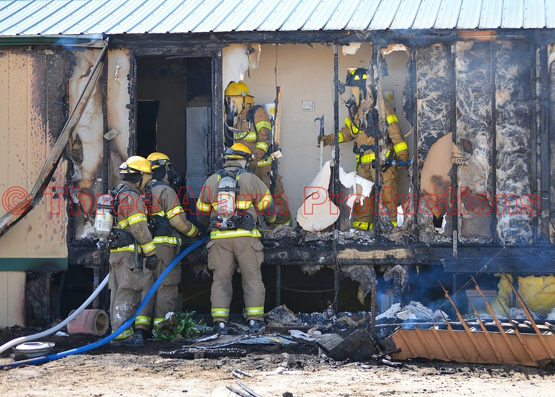 Ellicott and mutual aid department firefighters bring under control a working residential structure fire off of J D Johnson Road, in eastern El Paso County. April 8, 2015