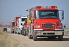 Multiple fire engines and water tenders staged on J D Johnson Road, in response for a working structure fire, in Ellicott, Colorado. April 8, 2015