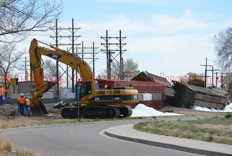 Railroad personnel continue to work on the repair and cleanup stages after a train wreck last night in Colorado Springs near Walter Drake Power Plant. April 13, 2015