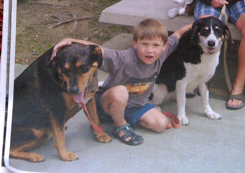 Copy shot of Jack Mollner with dogs, Belle (left) and Flicka. His dog, Belle, was shot by a police officer when the officer came to their home to take afraid report.