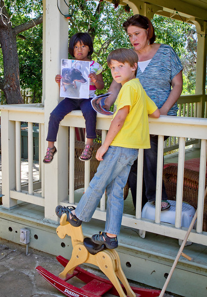Erika Gregory with her children, Jack and Lucy Mollner at their home in Vallejo, Calif., on Thursday, May 17th, 2012. Lucy holds up a picture of  their dog Belle who was shot by a police officer when the officer came to their home to take a fraud report.