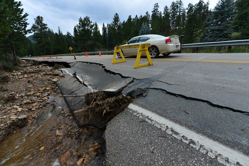 Part of Spur 66 lays collapsed on Saturday. The run off from the record rain undercut the road in several places.