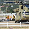 Workers unload a National Guard Chanook helicopter at the Stanley Fairgrounds on Friday. The huge helicopters have been used to evacuate people, as well as move supplies around the Front Range during the flood and early recovery efforts.