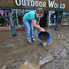 Friends and volunteers begin removing mud from Outdoor World on Saturday. Clean up began almost as soon as rain stopped falling, as Estes Park residents and businesses remover mud and debris.