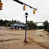 An Estes Park resident trudges through the toxic flood waters running through the intersection of Elkhorn an Moraine avenues on Friday, September 13. The floods that inundated the Colorado Front Range claimed at least eight lives and damaged 19,000 homes and buildings.