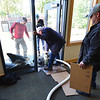 Friends of Kind Coffee help dry carpets in the coffee shop. As the sunshine returns, resolute Estes Park residents are hard at work to bring business back.