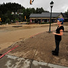 A local has a hard time looking at the destruction on Elkhorn Avenue on Friday. Most of the businesses in the downtown section of Elkhorn Avenue suffered some damage from the historic flood.