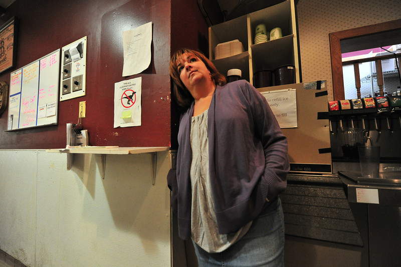 Julie Pieper shows the effects of long days of recovery from last week's flood. Pieper, co-owner of Poppy's and Mama Rose's, suspects she and her crew will need several weeks to get Mama Rose's open, and a little longer for Poppy's.