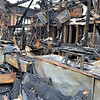 This was the bar area of the Pub and Grille. The fire destroyed two flat-screen televisions above the bar, along with the finely polished wood bar top and everything else in sight.