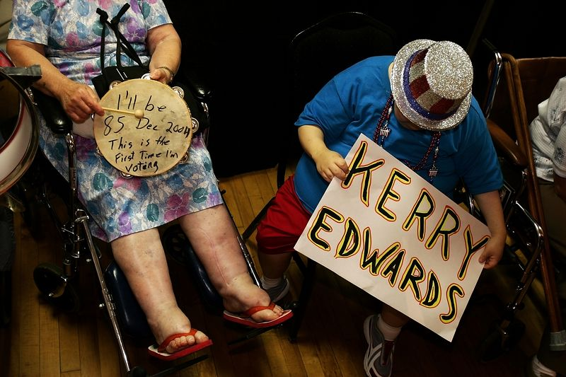 7/7/2004 -- St. Petersburg, Florida -- The Coliseum -- Florida residents sitting in the handicapped area show their support for Senators Kerry and Edwards through signage and props during a late-night rally in a packed Coliseum in St. Petersburg, Florida late Wedneday evening, July 7, 2004. On the right is Ileen Marie Hinchee (cq). On the left is 85-years-old, soon to be first-time-voter Rose Balasko. Photo by Dina Rudick, Boston Globe Staff. For story by either Raja Mishra or Glen Johnson.