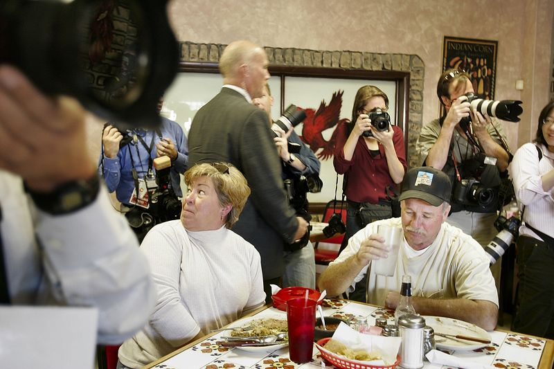 10/23/2004 -- Senator John Kerry stopped at the Red Rooster Cafe in Las Cruces, NM after a campaign rally on Saturday evening, October 23, 2004. After the stop at the cafe, Kerry attended 6:00 pm mass at Saint Anthony's Church. These people were caught in the crossfire of press photographer who piled into the small restaurant to photograph Kerry. Photo by Dina Rudick, Boston Globe Staff