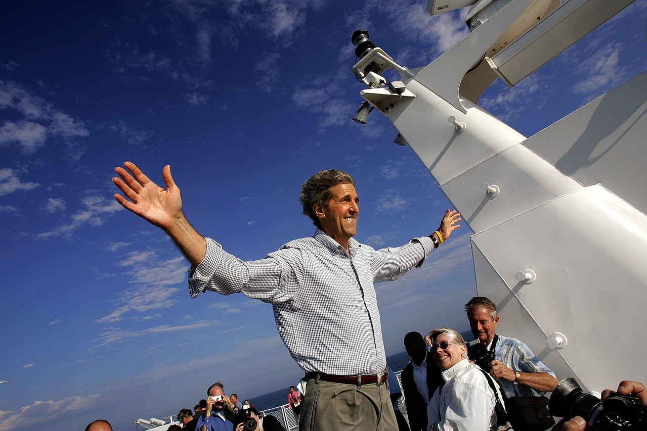 "8/3/2004 -- Lake Michigan -- Aboard the ship ""Lake Express"" -- Senator John Kerry frolics in the 40 MPH wind on the deck of Lake Express, a ferry that took him from Michigan to Wisconsin over Lake Michigan. Photo by Dina Rudick, The Boston Globe."