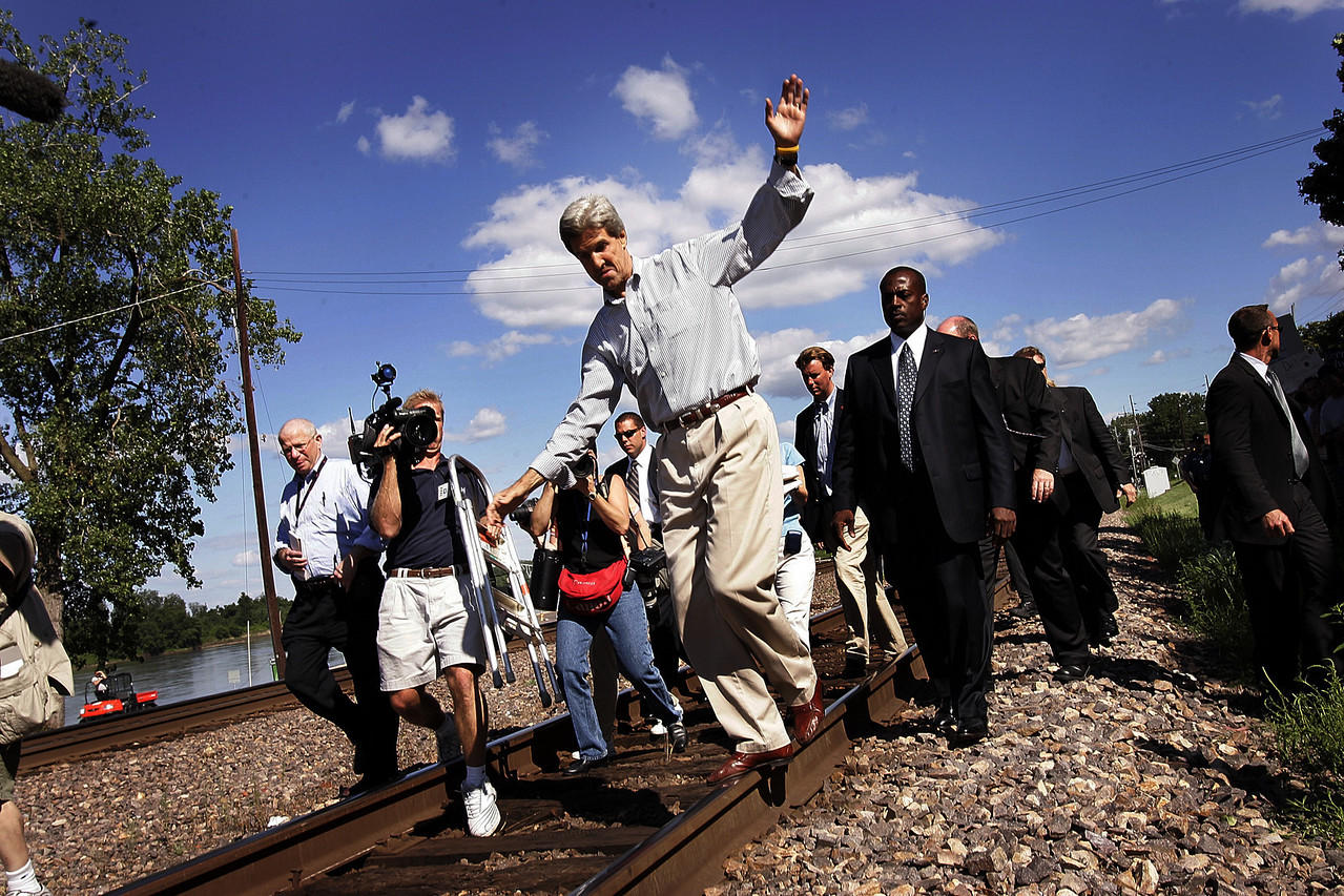 8/5/2004 -- Washington, MO --  Senators John Kerry and John Edwards made their first stop of their train tour in Washington, MO on Thursday afternoon, August 5, 2004. In this picture, Senator Kerry balances on the railroad rails while walking to shake hands with supporters. Photo by Dina Rudick, The Boston Globe.