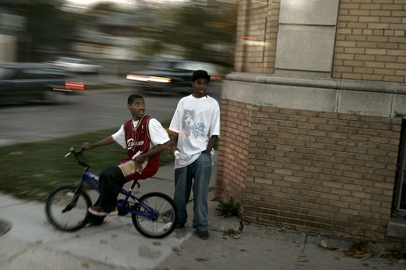10/25/2004 -- Greater Detroit, MI -- En route from Oakland airport to Warren, MI -- These young men were watching the motorcade pass on its way through the neighborhood on Monday, October 25, 2004. Photo by Dina Rudick, Boston Globe Staff