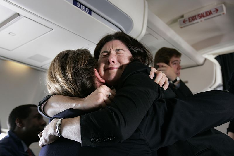11/2/2004 -- On Kerry campaign airplane from La Crosse, WI to Boston, MA -- Members of the campaign staff shed tears after Senator John Kerry personally thanked them for their hard work while on the airplane from Wisconsin to Massachusetts on voting day, November 2, 2004. Photo by Dina Rudick, Boston Globe Staff