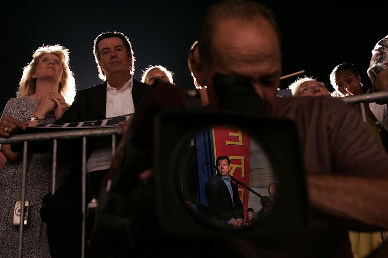 8/6/2004 -- Kansas City, MO -- Senator John Kerry held a rally in Kansas City on Friday night, August 6, 2004. In this picture, a Secret Service agent is reflected in a camera man's lens  during Senator John Kerry's speech.