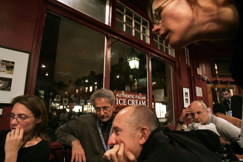 11/2/2004 -- Boston, MA -- Journalists from various media outlets crane their necks over election results while waiting for word from Senator John Kerry. The journalists set up camp in the Bella Vita Caffe in Beacon Hill on election night. Dina Rudick, Boston Globe Staff