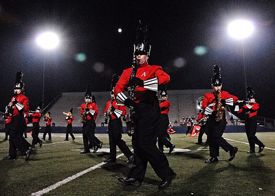 11-02-09  --marching band expo 01--  Allatoona junior Nick Laconte, center, plays the bass clarinet as he marches in step with the Marching Buccaneer Band on Monday night.  STAFF/LAURA MOON.